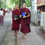 Amarapura - Two novices with food bowl